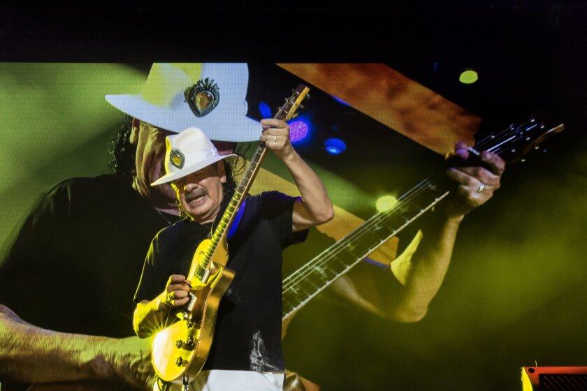 Carlos Santana performs in Tel Aviv, Israel, in July as part of his worldwide concert tour.