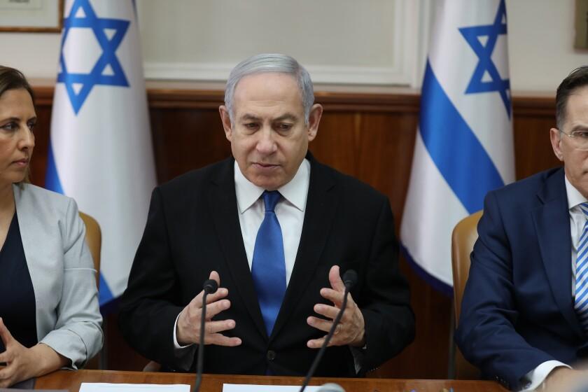 Israeli Prime Minister Benjamin Netanyahu attends the weekly cabinet meeting at his office in Jerusalem, Israel, Sunday, Dec. 1, 2019. (Abir Sultan/Pool Photo via AP)