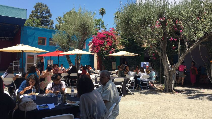 Attendees, including former L.A. Poet Laureate Luis Rodriguez, break for lunch in the courtyard betw