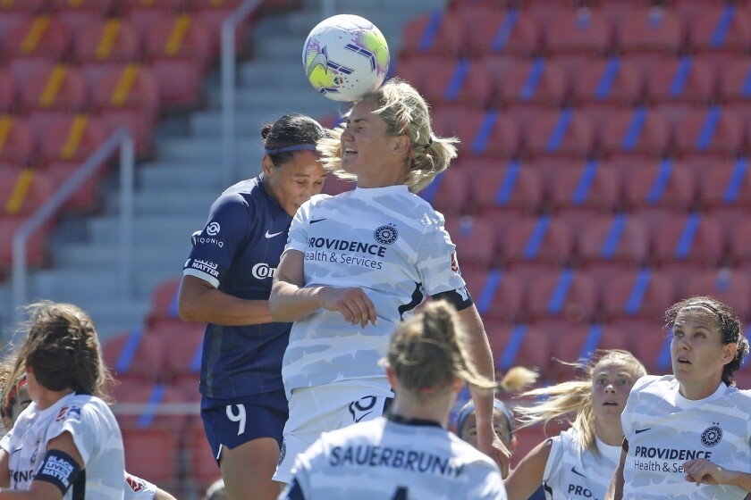 North Carolina's Lynn Williams and Portland's Lindsey Horan battle for the ball during the NWSL Challenge Cup on Saturday.
