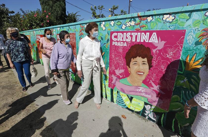 A mural honoring local 'poderosas' on Costa Mesa's Baker Street.