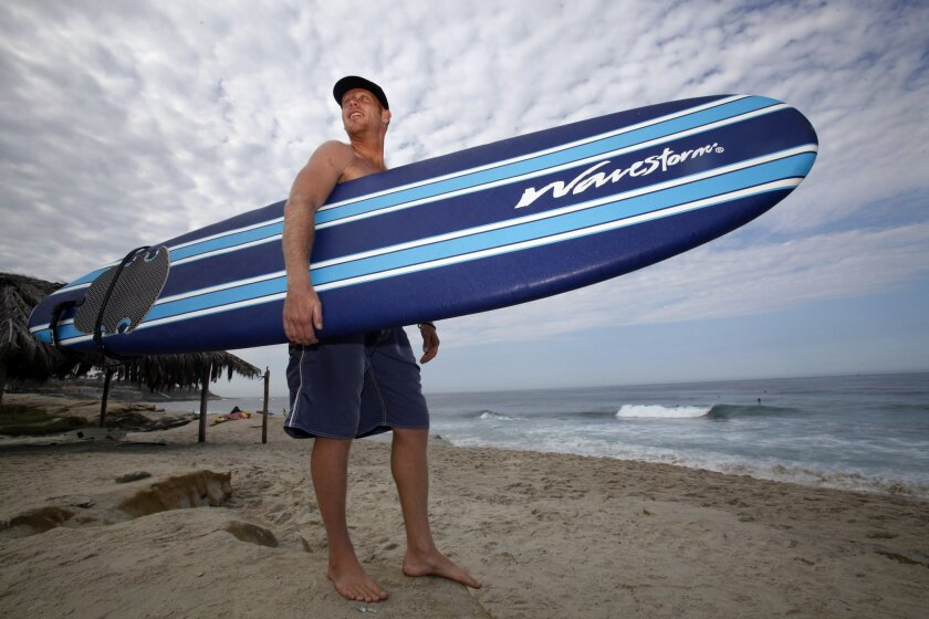 Craig Baldwin has made a name for himself surfing Costco brand foam Wavestorm surfboards. He overcame a debilitating immune system disease to nearly full physical strength and he credits both his wife Catherine and surfing with that rebound. .