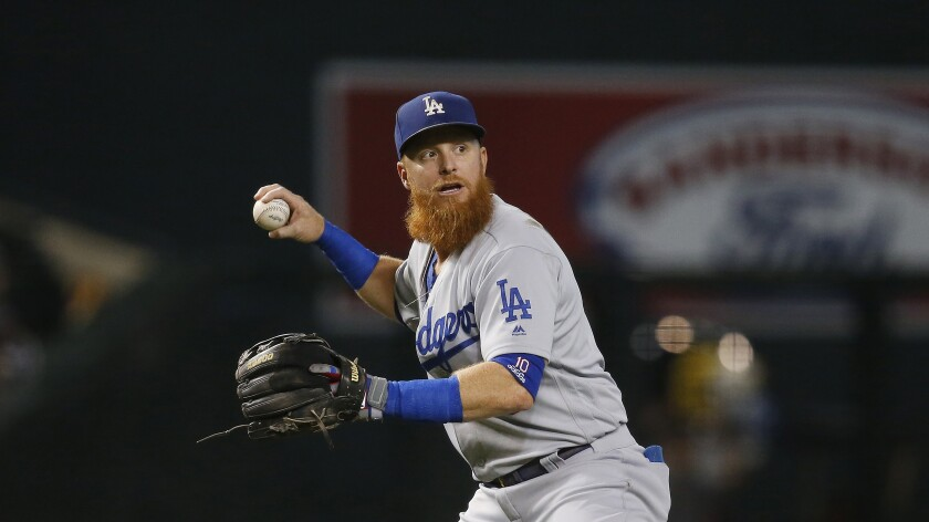 Dodgers third baseman Justin Turner gets set to throw to first base against the Arizona Diamondbacks during the first inning on Sept. 1 in Phoenix.