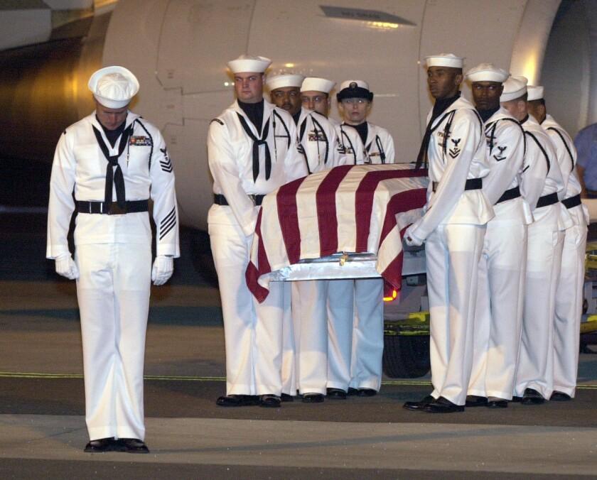 An honor guard carries the casket Navy Seaman Lakiba Nicole Palmer who was killed on the USS Cole