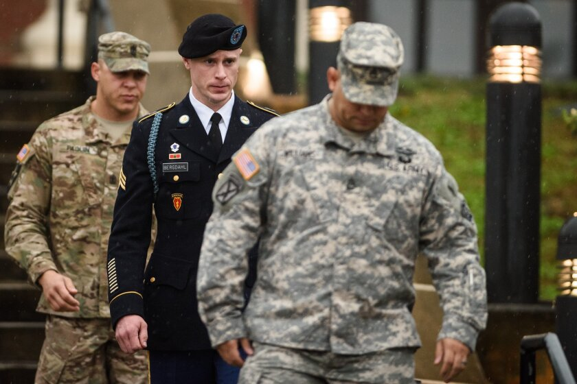 Army Sgt. Bowe Bergdahl, center, leaves the courthouse after his arraignment at Fort Bragg, N.C., in December 2015.