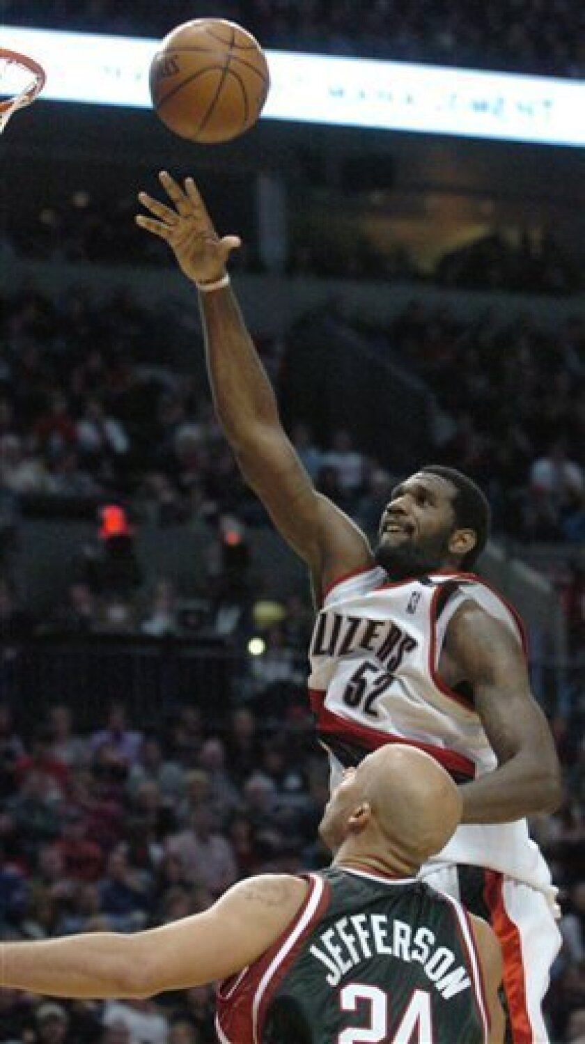 Portland Trail Blazers' Greg Oden (52) shoots over Milwaukee Bucks' Richard Jefferson (24) during the second half of an NBA basketball game in Portland, Ore., Monday, Jan. 19, 2009. Oden had a career-high 24 points and added 15 rebounds in the Trail Blazers' 102-85 victory over the Bucks.  (AP Phot