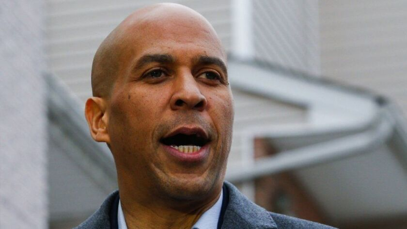 Sen. Cory Booker (D-N.J.) announces his presidential bid during a news conference Feb. 1 in Newark. His role in backing charter schools as that city's mayor has become an issue in his campaign.