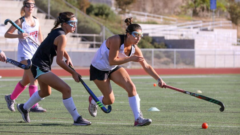 Vista High School field hockey player Bella Ianni, at right, controls the ball during practice.