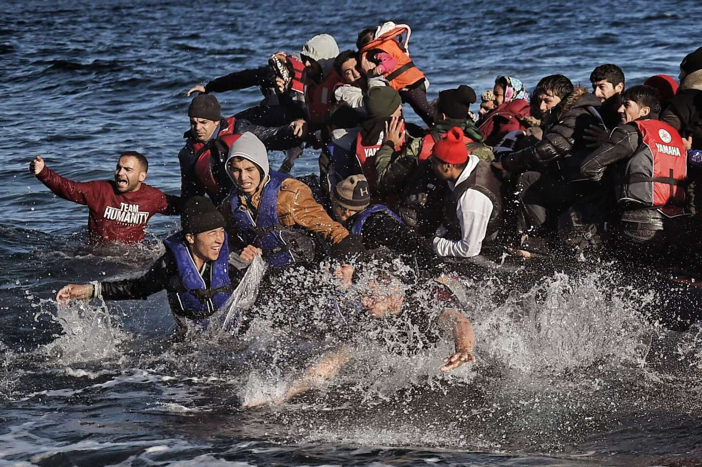 Migrants arrive on the Greek island of Lesbos after crossing the Aegean Sea from Turkey. More than 218,000 migrants and refugees crossed the Mediterranean to Europe in October -- a monthly record and more than during the whole of 2014.