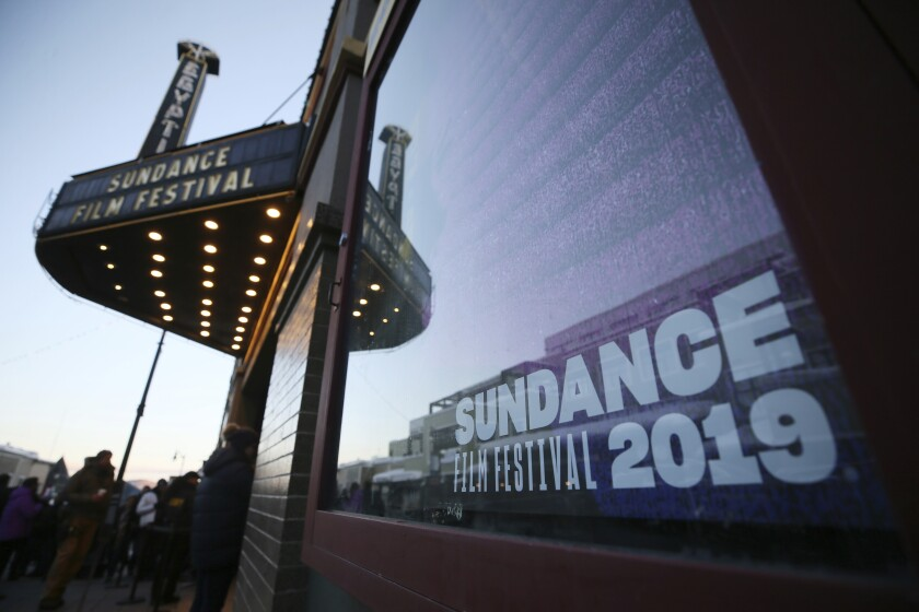 FILE - In this Friday, Jan. 25, 2019, file photo, shows the sun rise outside the Egyptian Theatre on Main Street before a morning premiere during the 2019 Sundance Film Festival, in Park City, Utah. Sundance Film Festival officials are trying to increase diversity among media covering the annual event in Park City by paying travel costs for about 50 journalists who are women, LGBTQ, minorities or have disabilities. The program has become so popular nearly 320 people applied this year. (Photo by Danny Moloshok/Invision/AP, File)
