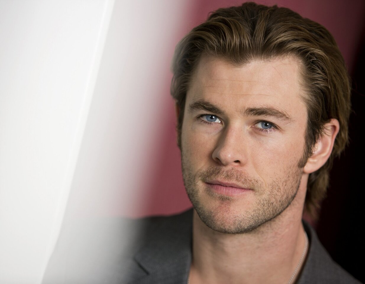 "In this Tuesday, Nov. 5, 2013 photo, Australian actor and star, Chris Hemsworth, of the upcoming film ""Thor: The Dark World,"" poses for a portrait, in New York.  Overseas, Disney's movie earned an impressive $109.4 million when it opened internationally last weekend. The Marvel sequel releases in t"