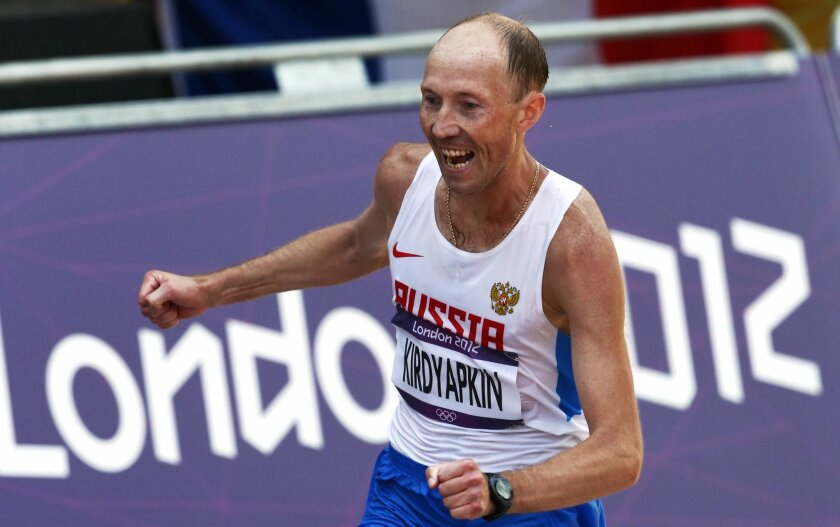 FILE - In this Saturday, Aug. 11, 2012 file photo Sergey Kirdyapkin, of Russia, wins the gold medal in the men's 50-kilometer race walk at the 2012 Summer Olympics, in London. Russia is a world leader in doping cases, with WADA statistics showing 225 violations across a variety of sports in 2013 _