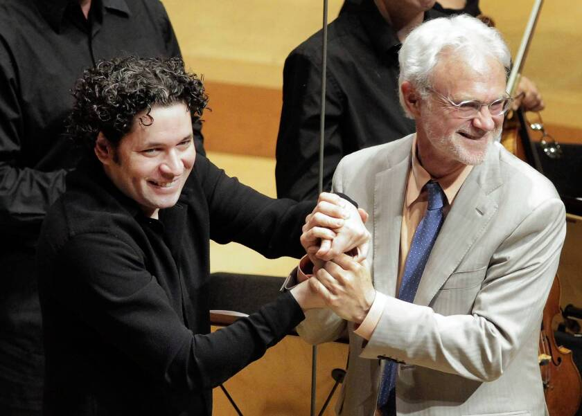 "Gustavo Dudamel, left, and John Adams acknowledge the applause after the performance of ""The Gospel According to the Other Mary."""