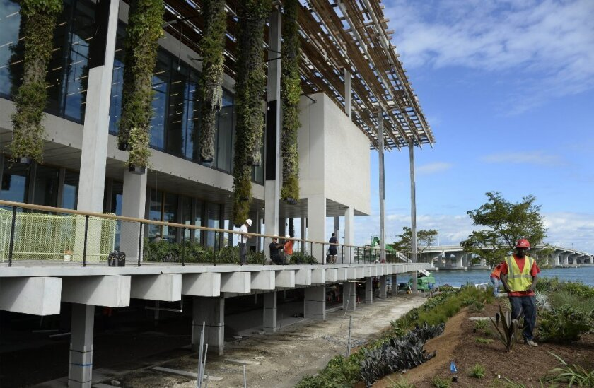 The Perez Art Museum Miami, bordering Biscayne Bay. Workers made finishing touches prior to Wednesday's opening.