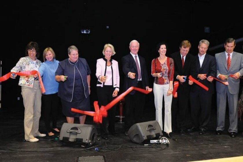 Rancho Santa Fe School board members join principal Lindy Delaney (third from left) in cutting the ribbon to open the new school. Photos by Jon Clark