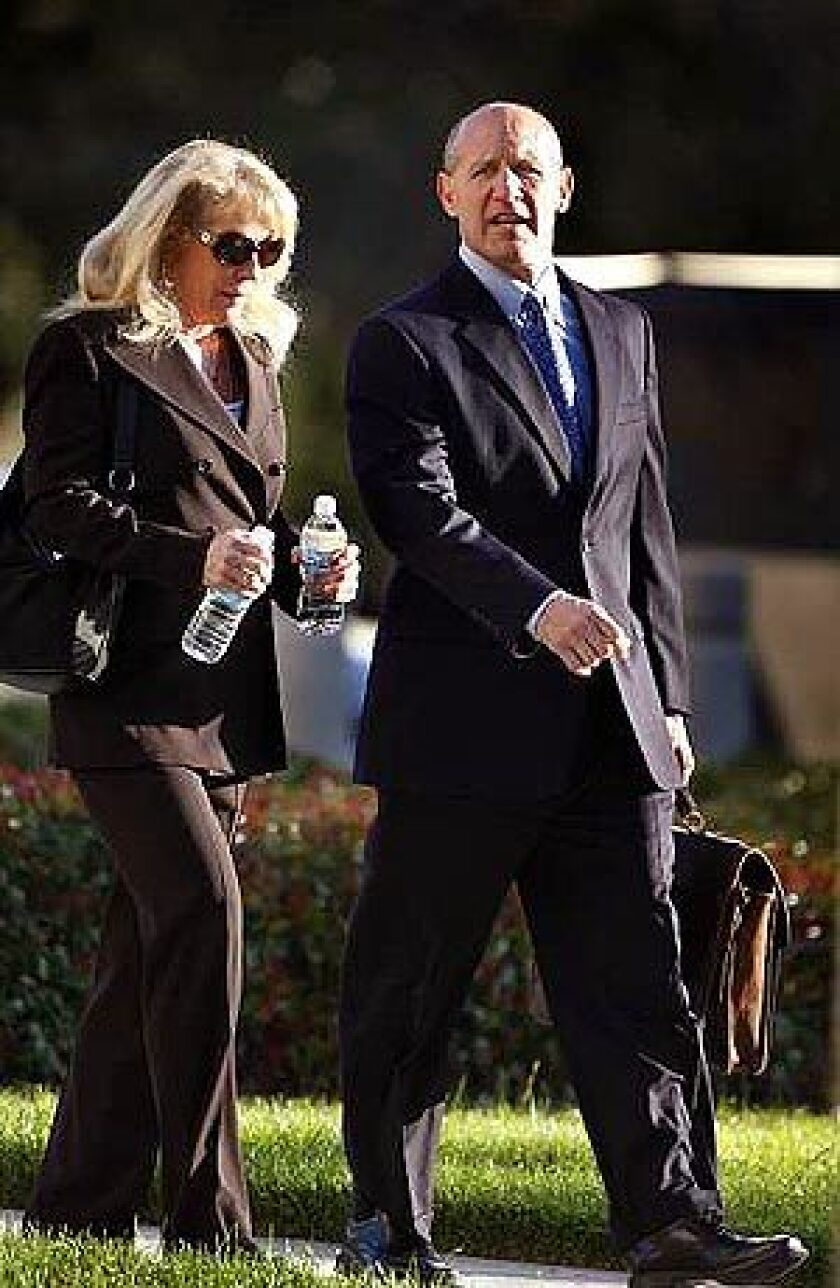 Former Orange County Sheriff Michael S. Carona and wife Deborah arrive at the federal courthouse in Santa Ana. A jury is expected to begin deliberations today in the corruption case against Carona.