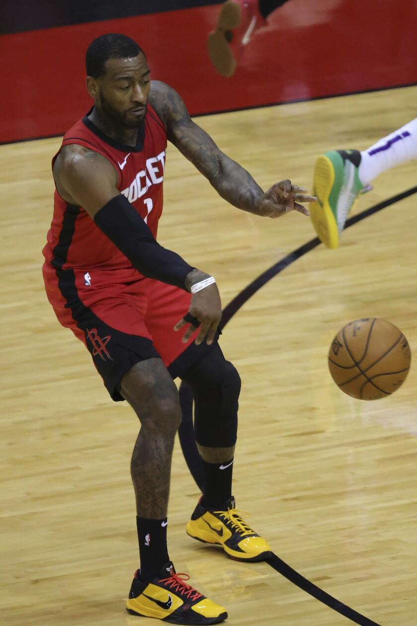 Houston Rockets' John Wall dishes the ball during the second quarter of an NBA basketball game against the Sacramento Kings, Saturday, Jan. 2, 2021, in Houston. (Carmen Mandato/Pool Photo via AP)