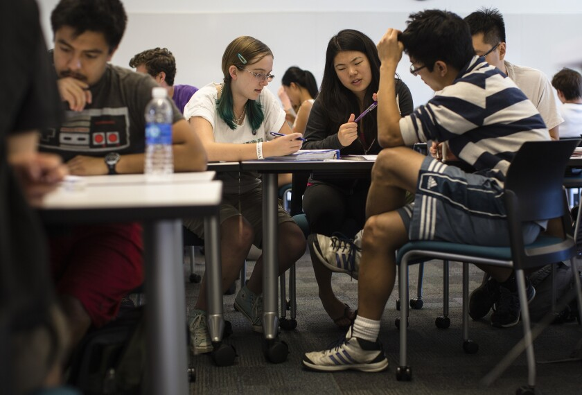 Students Nicole Kyle, Jessica Iwamoto, Daniel Nguyen and Yeahmoon Hong, right, work in a group to problem solve during a chemical and thermal processes class at Harvey Mudd College in Claremont.
