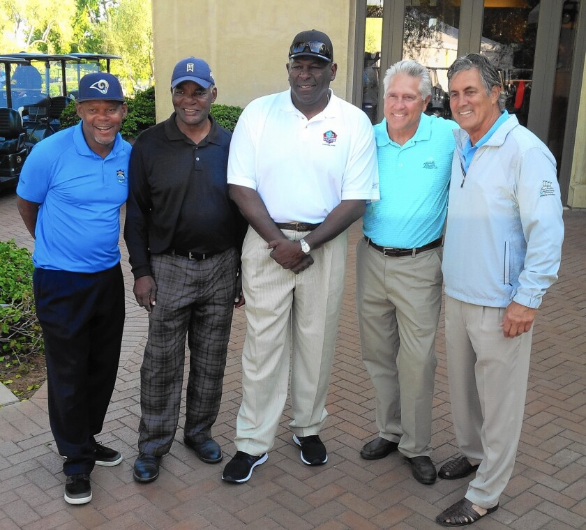 From left, former Rams LeRoy Irvin, Lawrence McCutcheon, Jackie Slater, Nolan Cromwell and Vince Ferragamo participate in the Rich Saul Memorial Golf Classic in 2016.