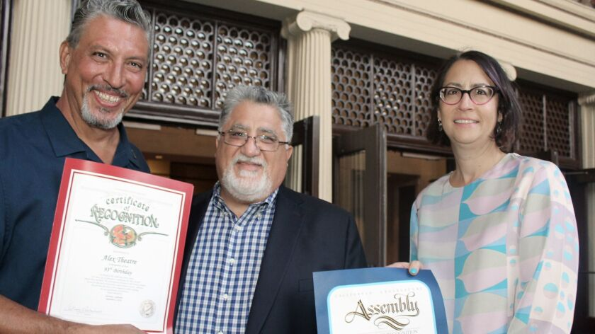 Vincent Espinoza Glendale Arts Board Chair (on left) is presented with certificates of recognition f