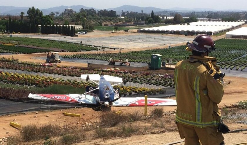 This small plane landed upside down in a nursery in a bad landing at Fallbrook Community Airpark Wednesday. The pilot and passenger were not hurt.