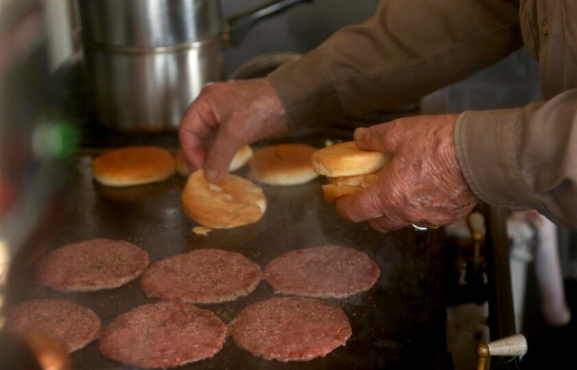 Bill Elwell, 93, is still flipping burgers at his roadside stand.
