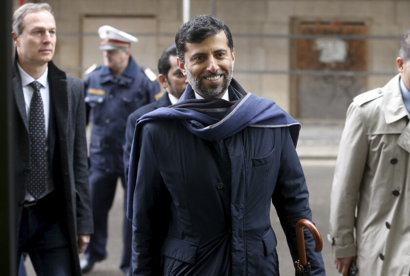 FILE - In this March 6, 2020 file photo, Minister of Energy and Industry of the United Arab Emirates, UAE, Suhail al-Mazrouei, center, arrives for a meeting of the Organization of the Petroleum Exporting Countries, OPEC, and non OPEC members at their headquarters in Vienna, Austria. The UAE is pushing back against a plan by the OPEC oil cartel and allied producing countries to extend the global pact to cut oil production beyond April 2022. In an interview with CNBC on Sunday, July 4, 2021, al-Mazrouei voiced concerns over the Saudi-led production restraints. (AP Photo/Ronald Zak, File)