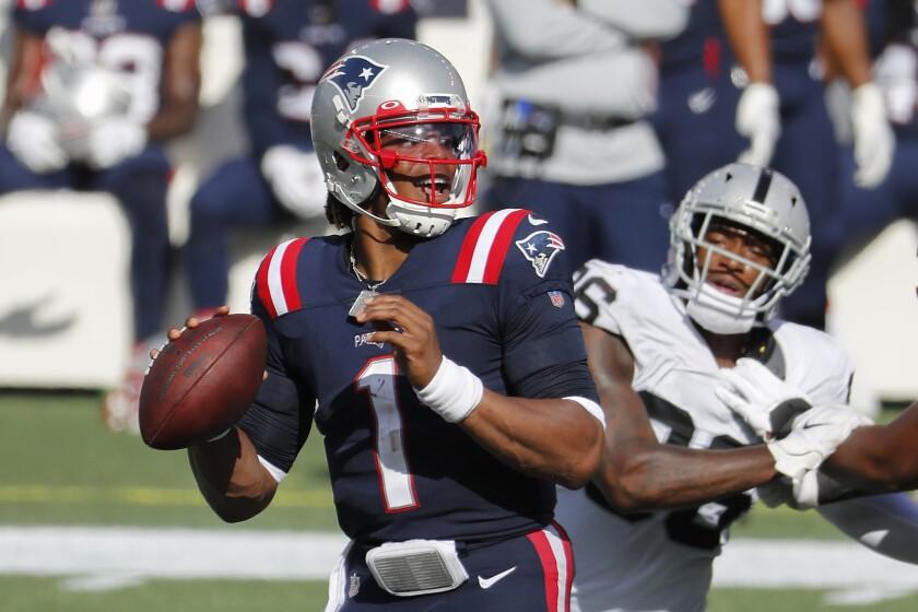 New England Patriots quarterback Cam Newton looks to pass against the Las Vegas Raiders.