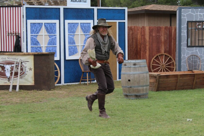 Michael Gilliland as Ace Diamond with the Ramona Desperados steals away with the bank deposit during the Desperados' skit during last year's Old West Days.