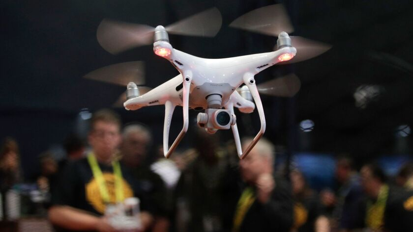 FILE - In this Jan. 5, 2017 file photo, an exhibitor demonstrates a drone flight at CES Internationa