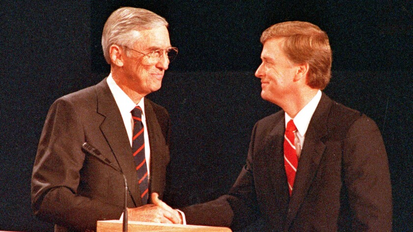 In 1988, Democratic vice presidential nominee Sen. Lloyd Bentsen, left, and his Republican opponent, Sen. Dan Quayle, shake hands after their debate in Omaha, Neb.