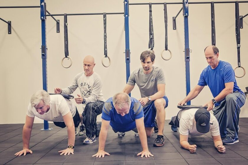 Clayton MD Total Health Center is a comprehensive health and fitness program designed by Dr. Dave Clayton (kneeling, center) that also offers mental training.