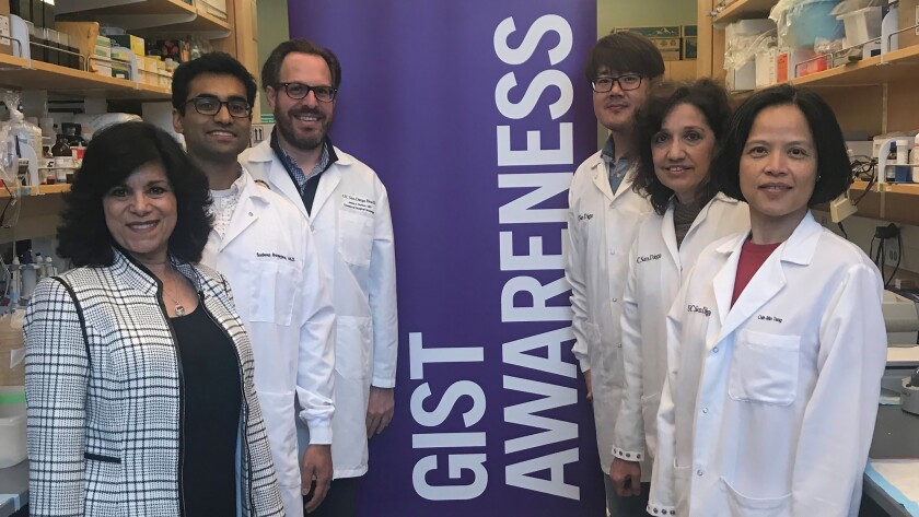 Dr. Jason Sicklick (third from the left) with some of the lab team at Moores Cancer Center at UC San Diego Health