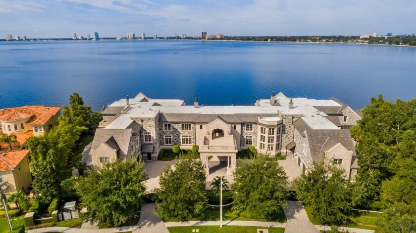 A mansion overlooks a bay.