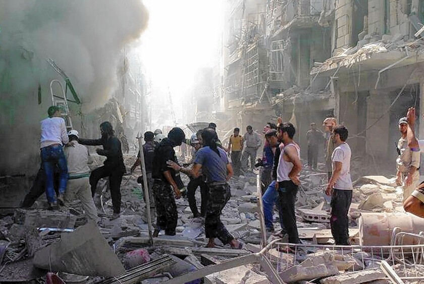 Syrians inspect the damage after a government airstrike in the Karm al Jabal area of Aleppo on June 26.