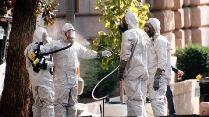 A hazardous materials worker is hosed down on Capitol Hill in October 2001. The mailing of anthrax-laced letters that fall gave momentum to the idea that the military needed defenses against biological threats.