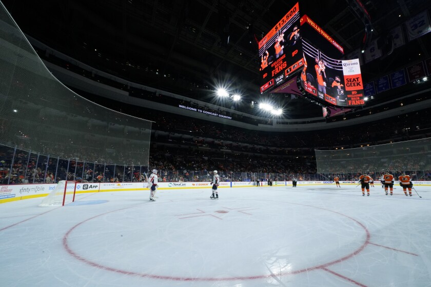 Players skate off the ice after a power outage during the second period of a preseason NHL hockey game between the Philadelphia Flyers and the Washington Capitals, Saturday, Oct. 2, 2021, in Philadelphia. (AP Photo/Matt Slocum)