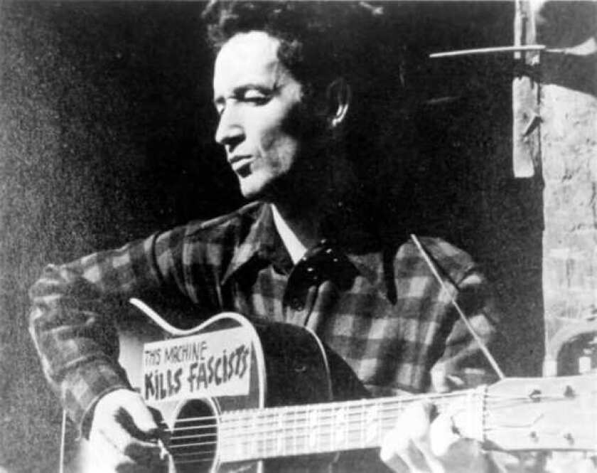 """Woody Guthrie's career is examined in new three-CD box set, """"Woody at 100,"""" being released by Smithsonian Folkways Recordings."""