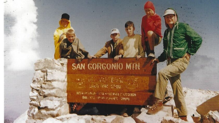 """Richard """"Dick"""" Preece, right, poses with Boy Scouts during a hike in the San Bernardino Mountains in 1973. On Sept. 13, the 86-year-old Vista resident was honored for 75 years of continuous service to Boy Scouts of America."""