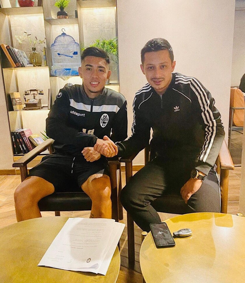 Former Fremont soccer standout Bryan Joel Rodriguez (left) on the day he signed a contract to play professionally in Albania.