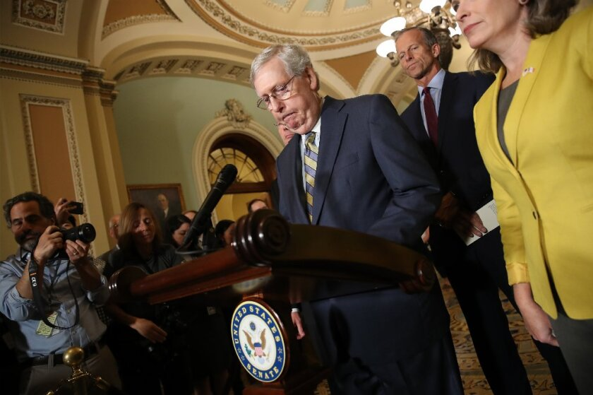AFP-Getty_Senate Lawmakers Speak To The Media After Their We.JPG