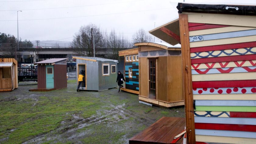 The tiny houses built for a new homeless village in Portland, Ore., do not have running water or electricity, but they do have solar panels that can power a cellphone.