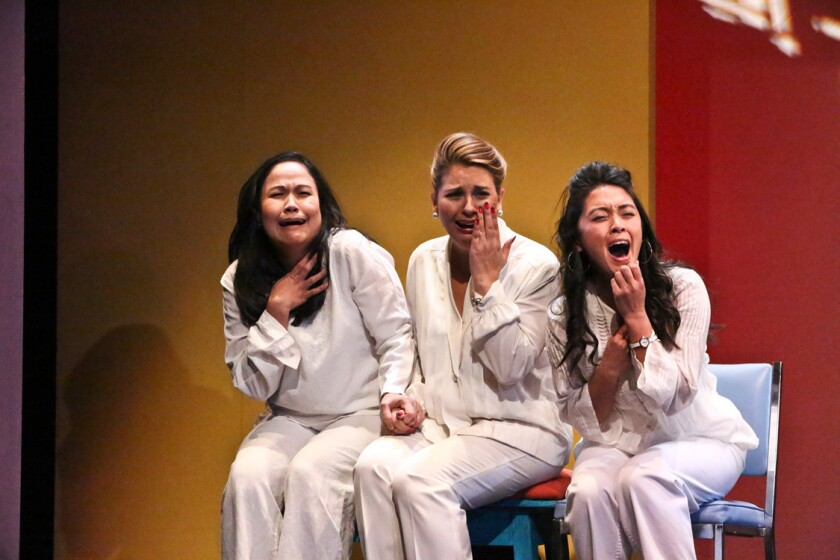 """Joan Almedilla, Giselle """"G"""" Töngi, and Samantha Cutaran in East West Players' production of Giovanni Ortega's """"Criers for Hire."""""""