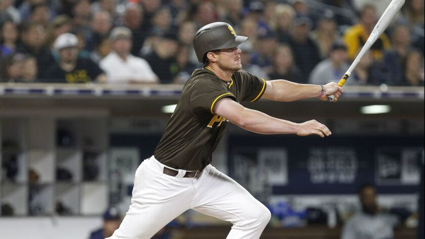 Wil Myers hits a single in the fourth inning against the Milwaukee Brewers on Friday.