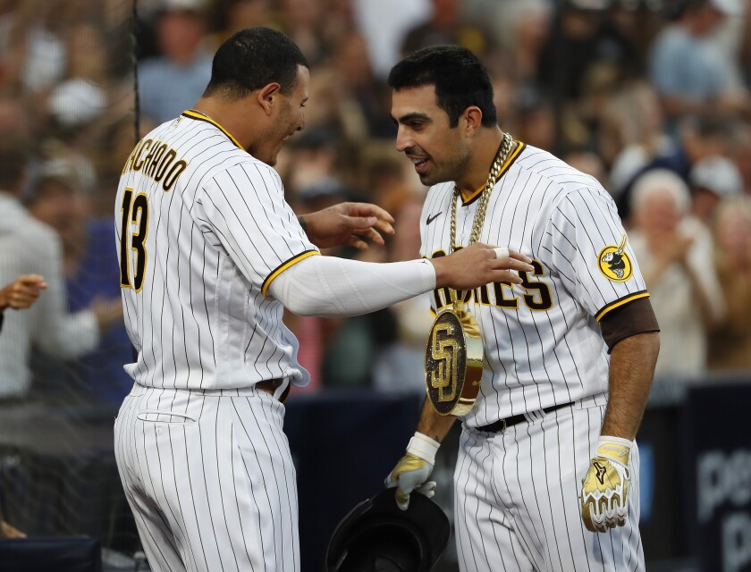 The Padres' Daniel Camarena gets the swagg chain from Manny Machado