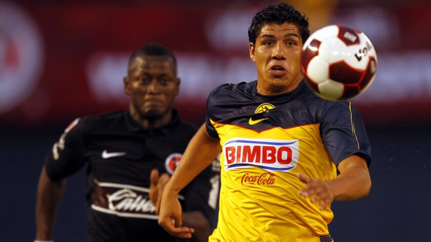 Club America's Erik Pimentel (right) and Tijuana Xolos' Duvier Riascos battle during a 1-1 draw at Qualcomm Stadium.