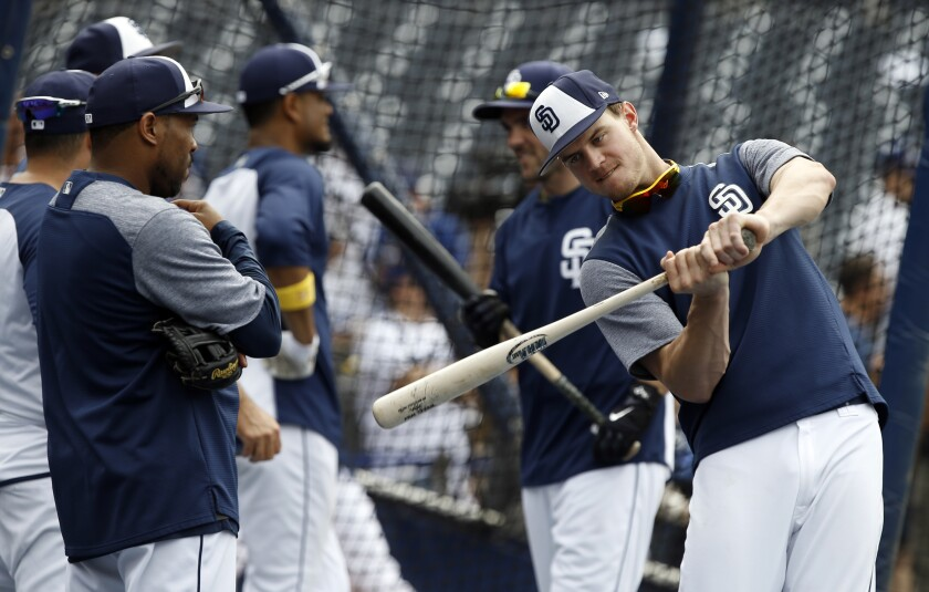 Johnny Washington (left), observing Wil Myers' swing, is the latest in a long line of Padres hitting coaches. The position has not had a lot of job security.