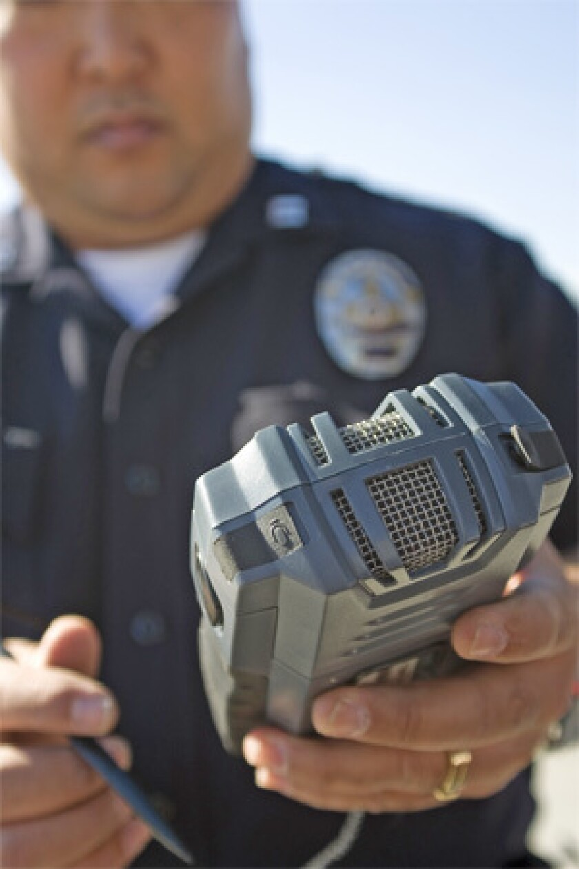 GETTING THE WORD OUT: Los Angeles police Capt. Dennis Kato demonstrates the Phraselator, a new device that helps police communicate with the public in many languages.