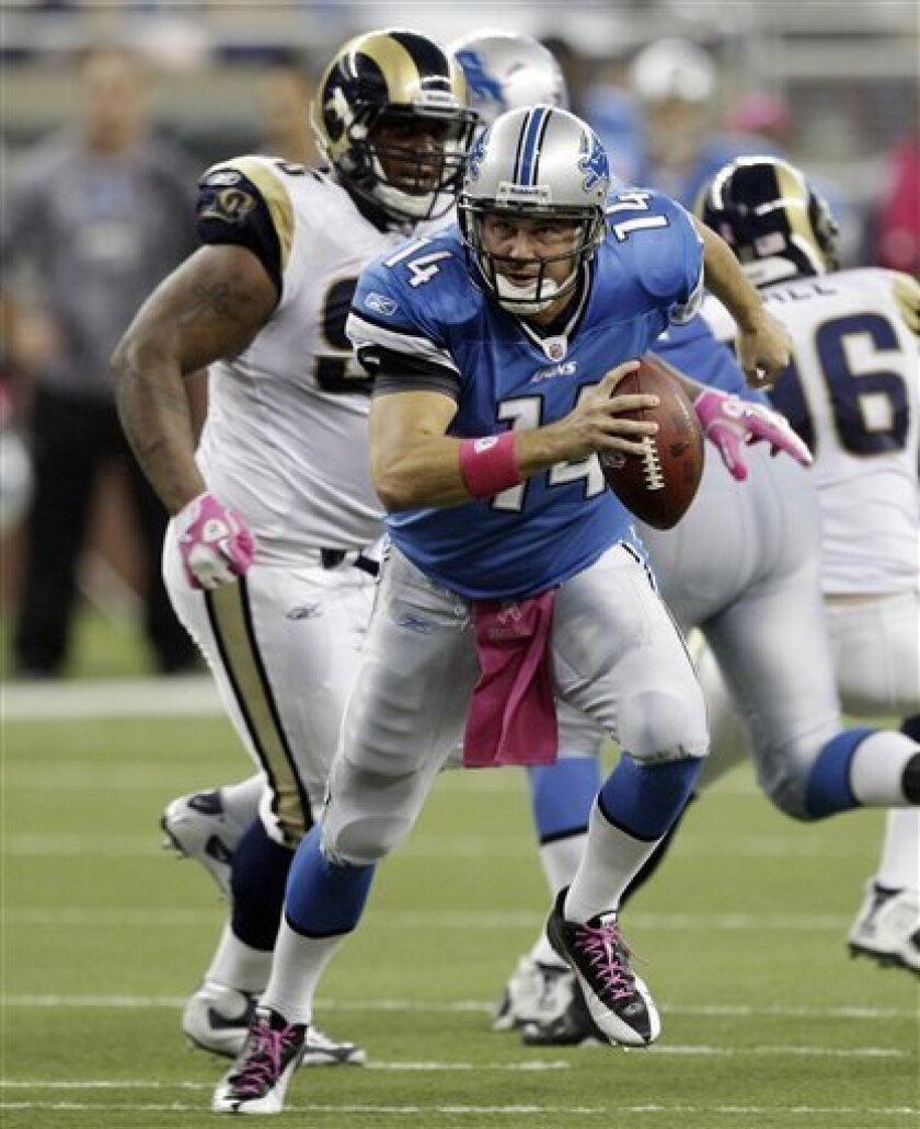 Detroit Lions quarterback Shaun Hill (14) scrambles against the St. Louis Rams in the second quarter of an NFL football game in Detroit, Sunday, Oct. 10, 2010. (AP Photo/Paul Sancya)