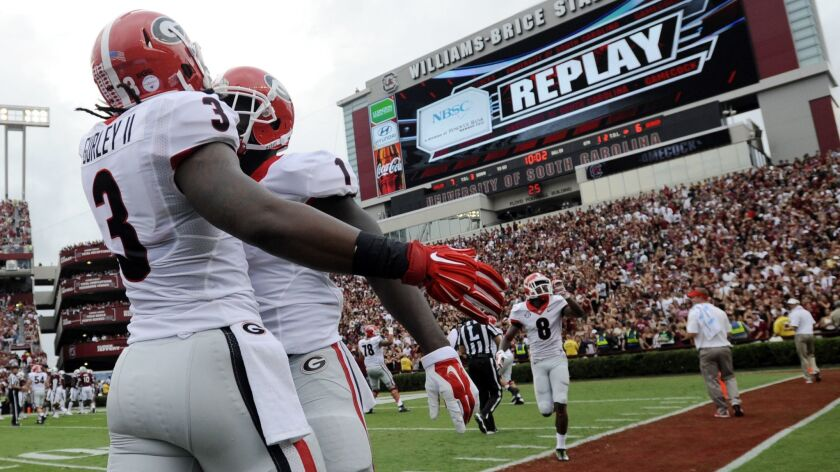 FILE- In this Sept. 13, 2014, file photo, Georgia running back Sony Michel (1) celebrates with teamm